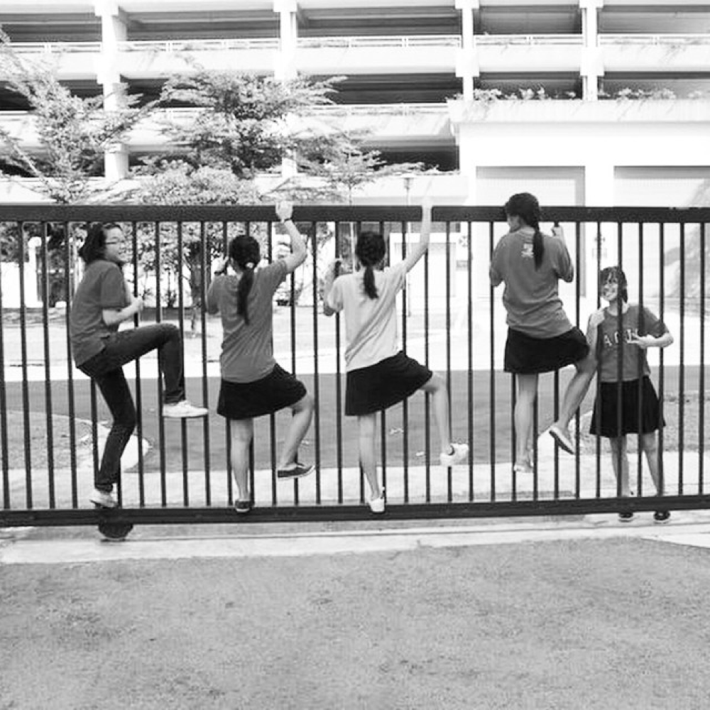 ACJC Students Climbing Gate
